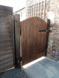 Hang new garden side gate and stain