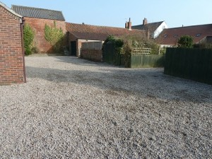 20 tonnes of gravel on communal parking area
